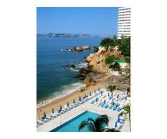 Acapulco Suite sobre playa, a la orilla del mar, vacaciona